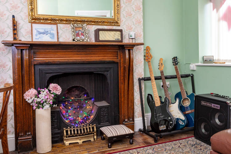 The Gladys Heatley Room - Fireplace and guitars